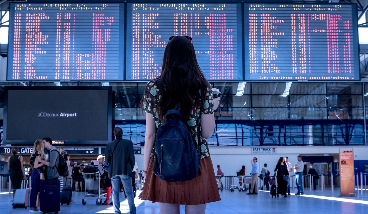 Girl standing at airport departures