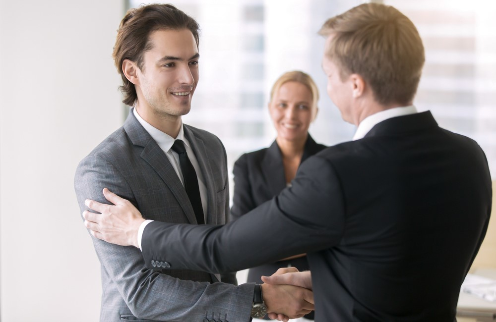 Employee experience - employer shaking hands with candidate